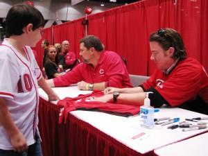 Hanigan signing autographs.