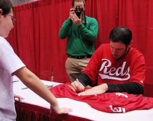 Ondrusek signs a jersey.